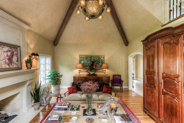 vaulted ceiling in living room with beams