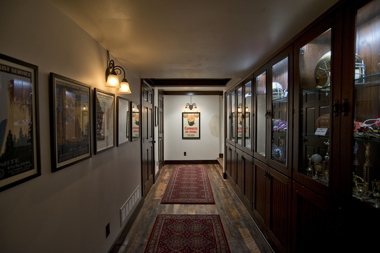 lower level hallway with sports memorabilia display cases