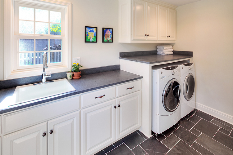 custom laundry room designed by john wind