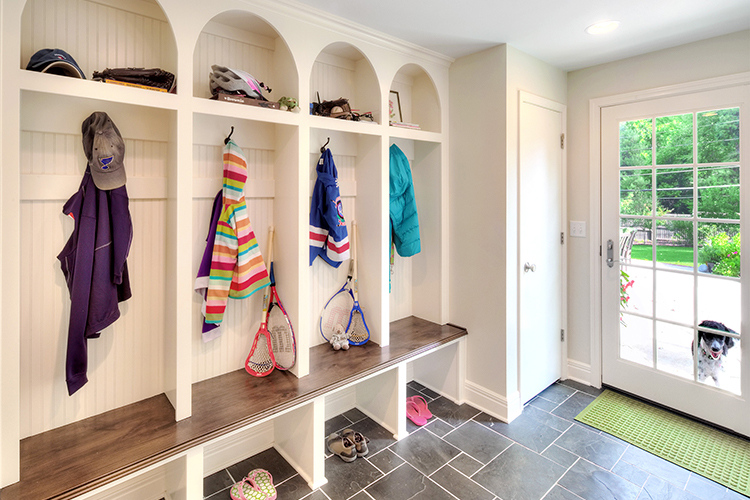custom cabinetry mudroom with slate floor
