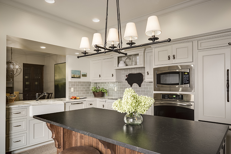 scovell wolfe remodeled kitchen with black granite island