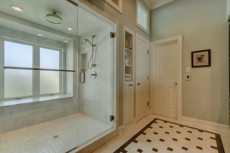 hallbrook master bathroom with frameless glass shower doors