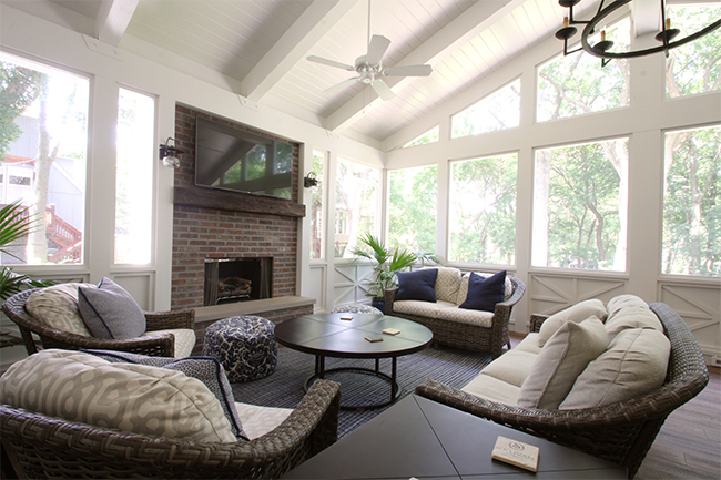 seating area of the screened in porch by beth phillips interior design and scovell wolfe