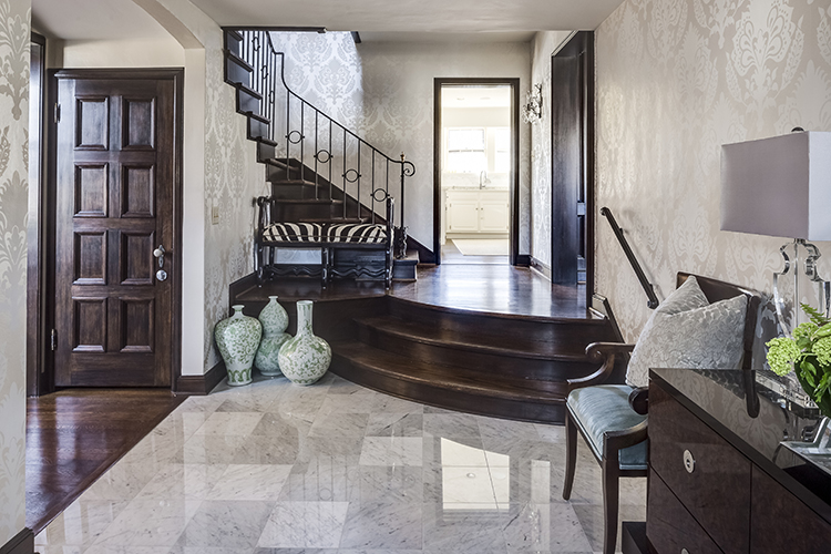 carrara marble entry way with grand stairs by scovell wolfe