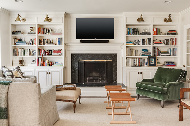 built in entertainment center with visual comfort brass sconces