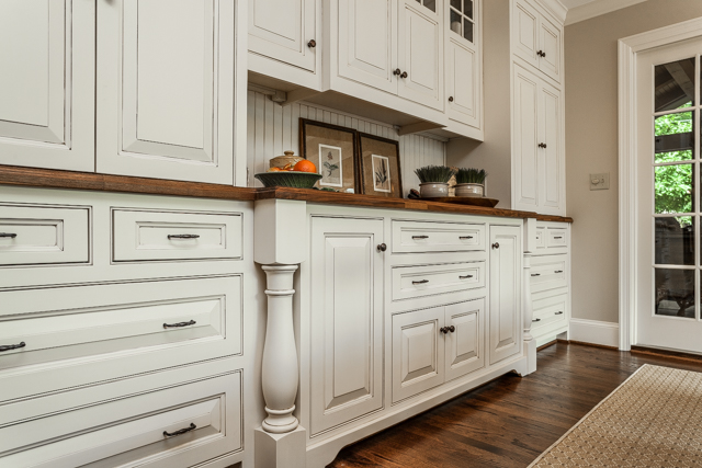custom kitchen cabinetry with walnut countertop