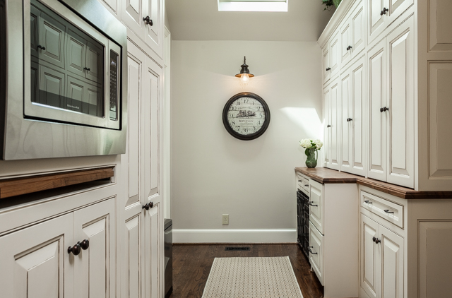 mudroom and pantry with built-in microwave