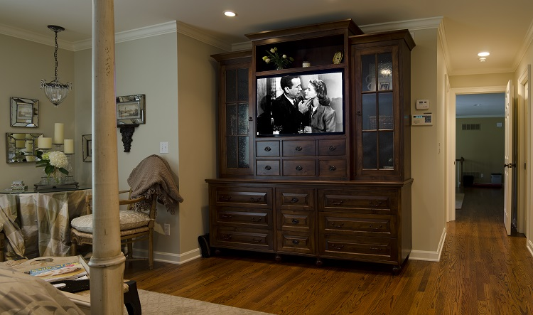 custom built entertainment center in the master bedroom
