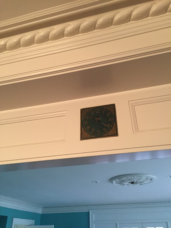 built-in clock above dining room cased opening