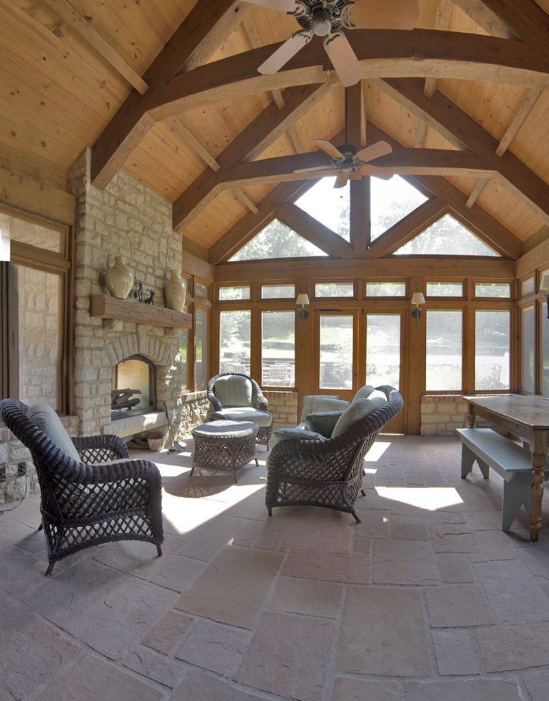 interior screened in porch with fireplace