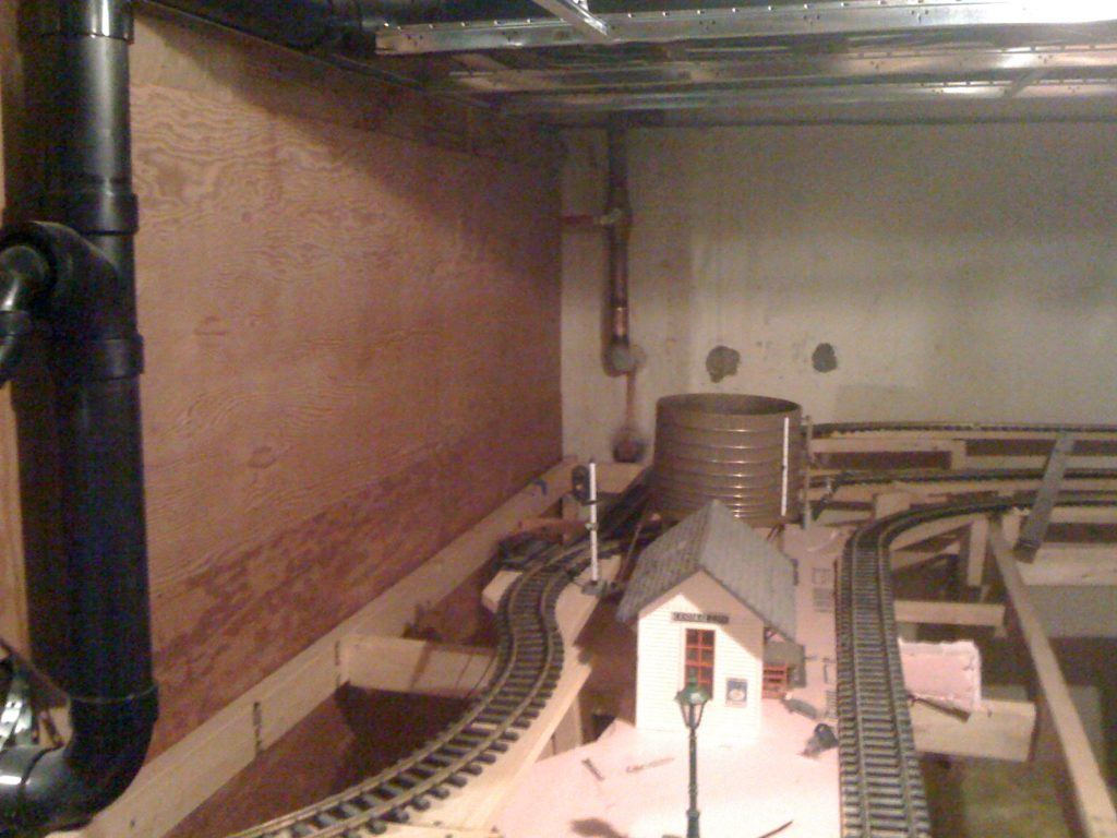 train track set up in unfinished section of basement