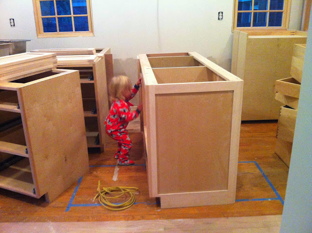 annie playing in the custom cabinetry built by noal at scovell wolfe