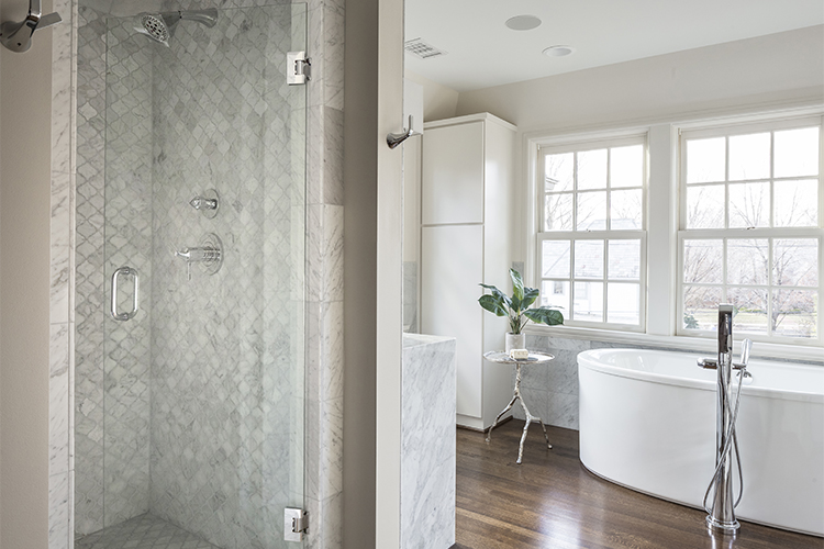 scovell wolfe designed master bathroom with carrara marble and freestanding tub