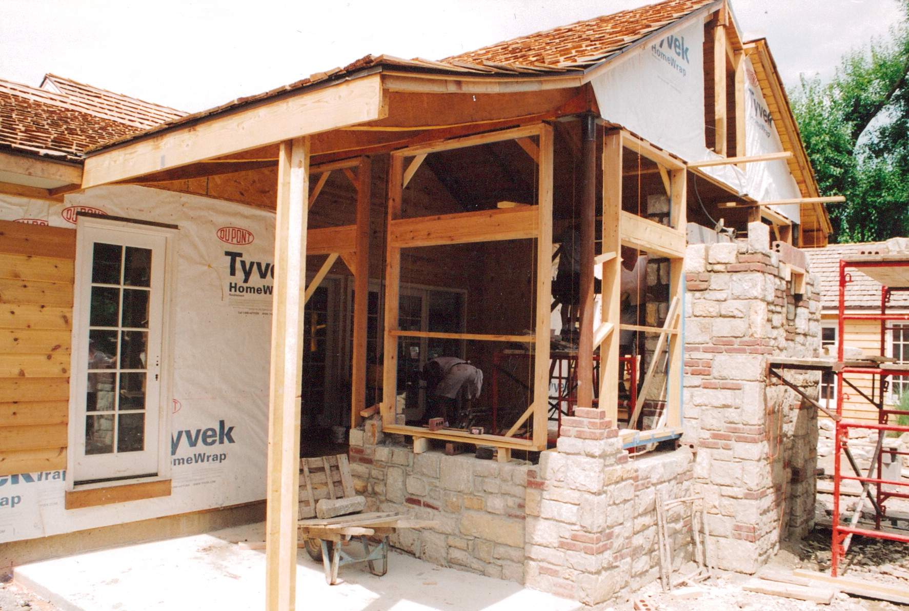 screened porch being built. masonry work