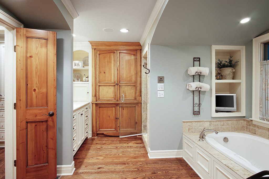master bathroom after with pine medicine cabinet