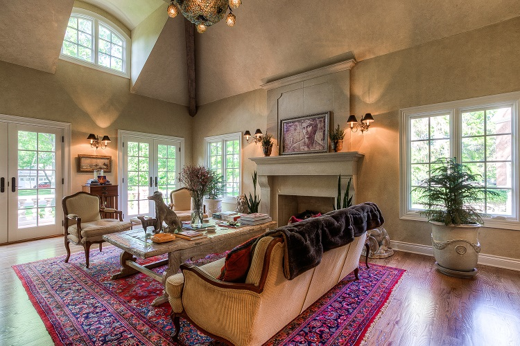 scovell wolfe custom home with tall ceilings and fireplace