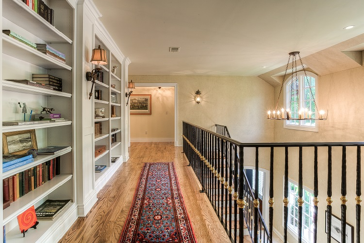 kansas city custom home upstairs hallway with wrought iron bannister