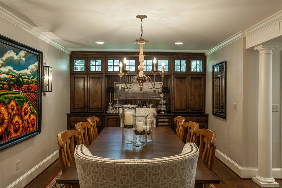 dining room with wet bar and transoms