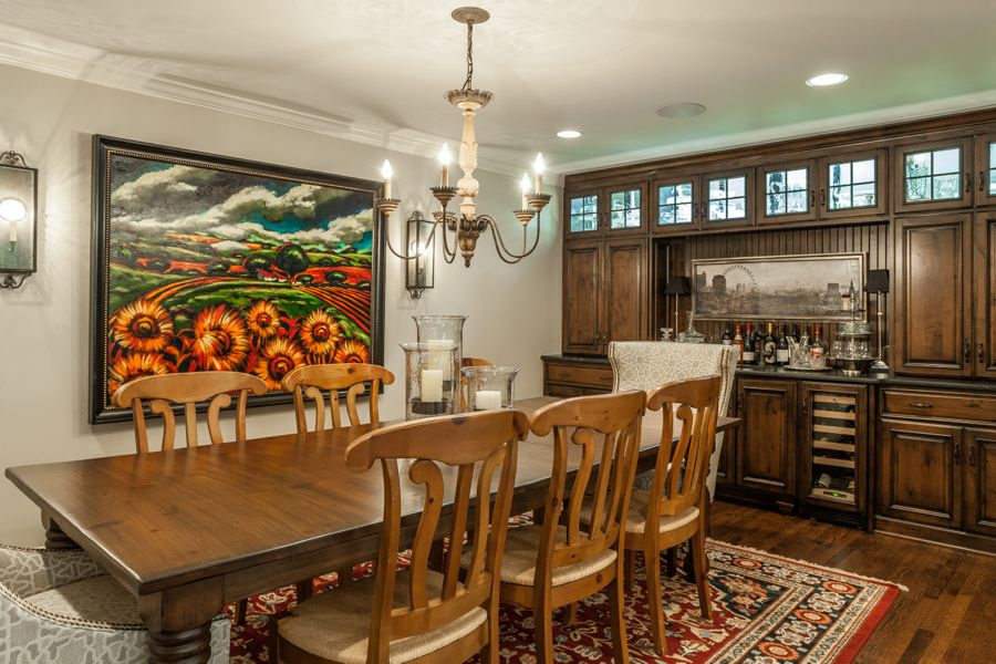 dining room and wet bar with sunflower art