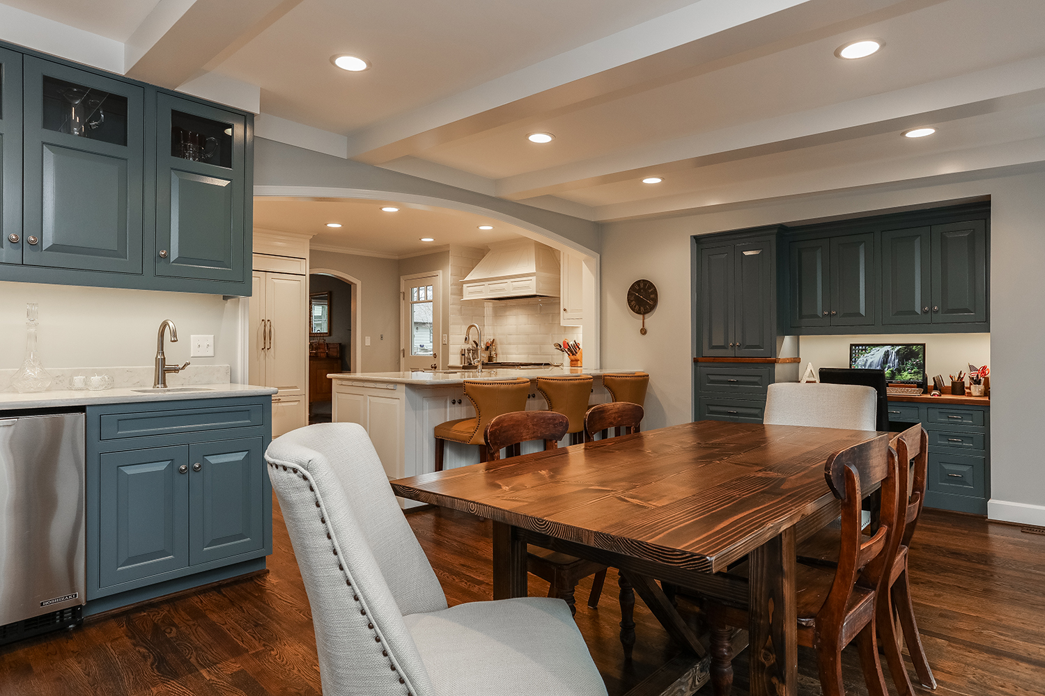 wet bar in a breakfast room with a built in office space adjoining the kitchen