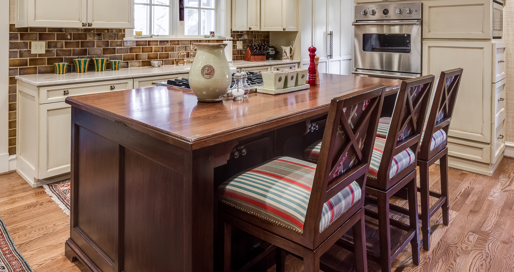 kitchen island with upholstered bar stools
