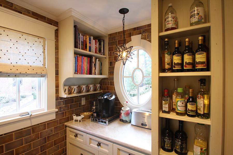 coffee prep station with original oval window and doorless cabinet shelves