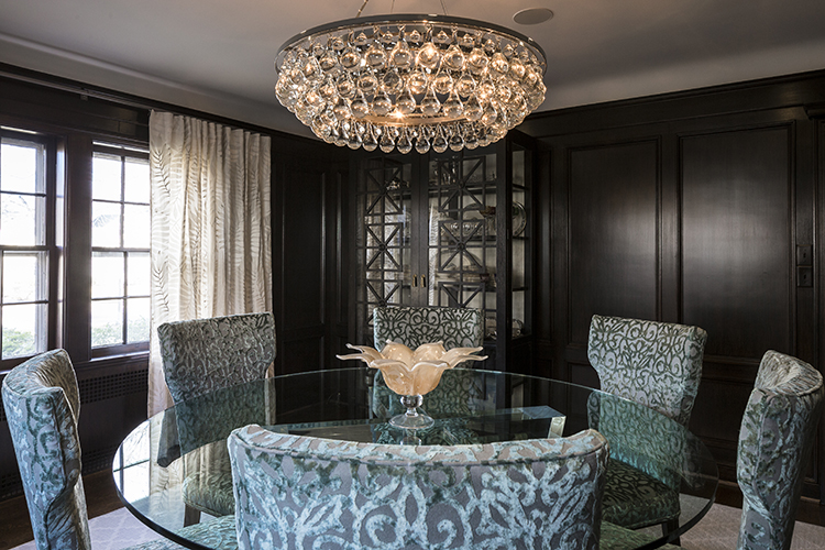 dark stained wainscoting in dramatic dining room by scovell wolfe