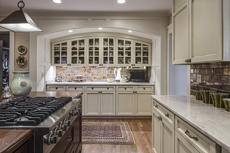 dry bar with arched cabinetry in kitchen by scovell wolfe