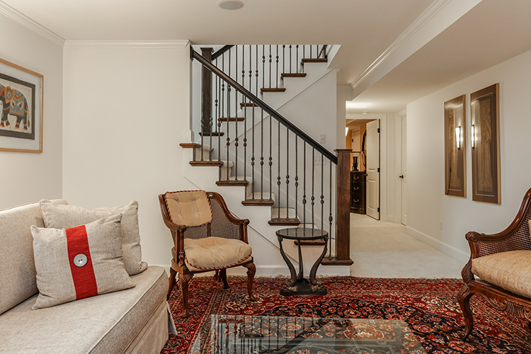 exposed wrought iron railing in lower level of prairie village new build