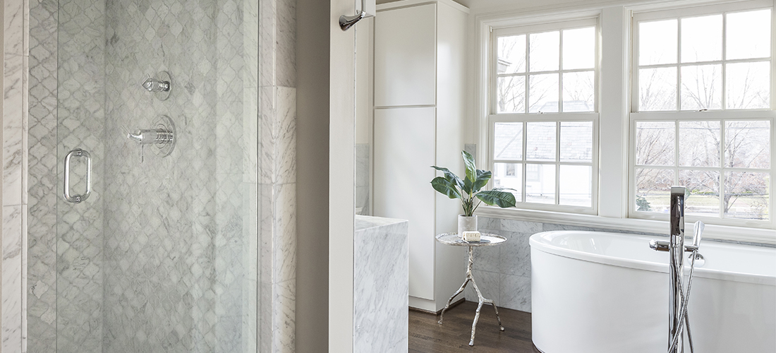 carrara marble shower and vanity with free standing tub designed by scovell wolfe