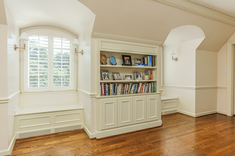 built in bookcases and window seats in master suite by scovell wolfe with marvin windows