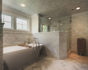 carrara marble bathroom in sunset hills with freestanding tub and frameless shower doors