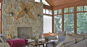 stone fireplace on screened porch
