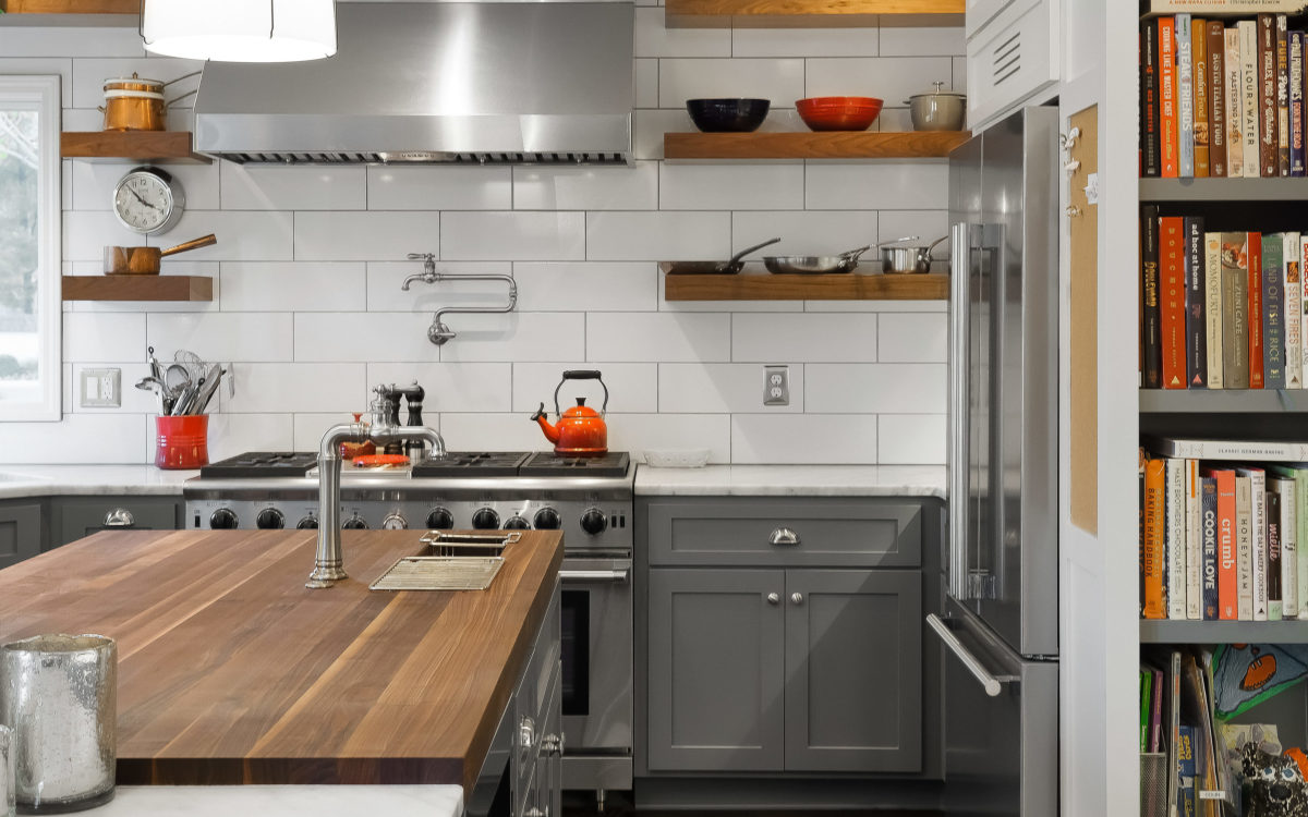 floating walnut shelves with oversized subway tile and butcher block