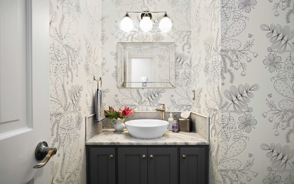 wallpaper in the remodeled powder bathroom of this scovell remodel