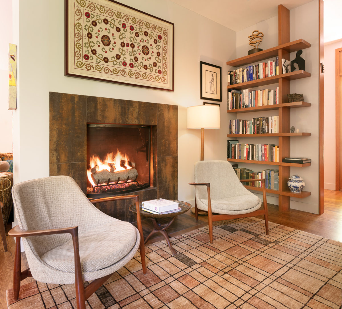 modern fireplace with custom cherry shelves by scovell remodeling