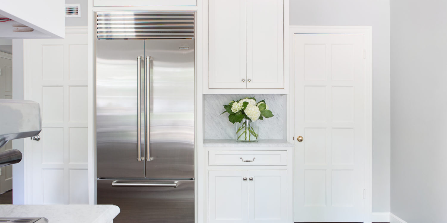 subzero built in refrigerator in a mission hills kitchen with slab backsplash and custom cabinetry