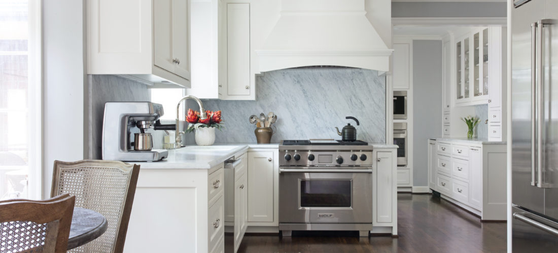 marble slab backsplash with custom cabinetry and wolf range in mission hills kitchen remodel