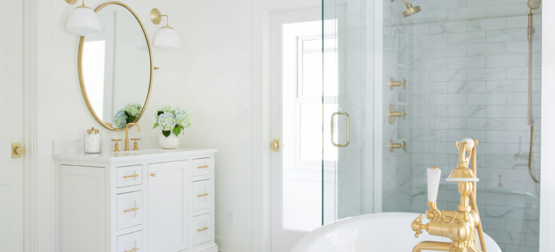 custom master bathroom with kohler brushed gold, custom cabinetry and marble shower