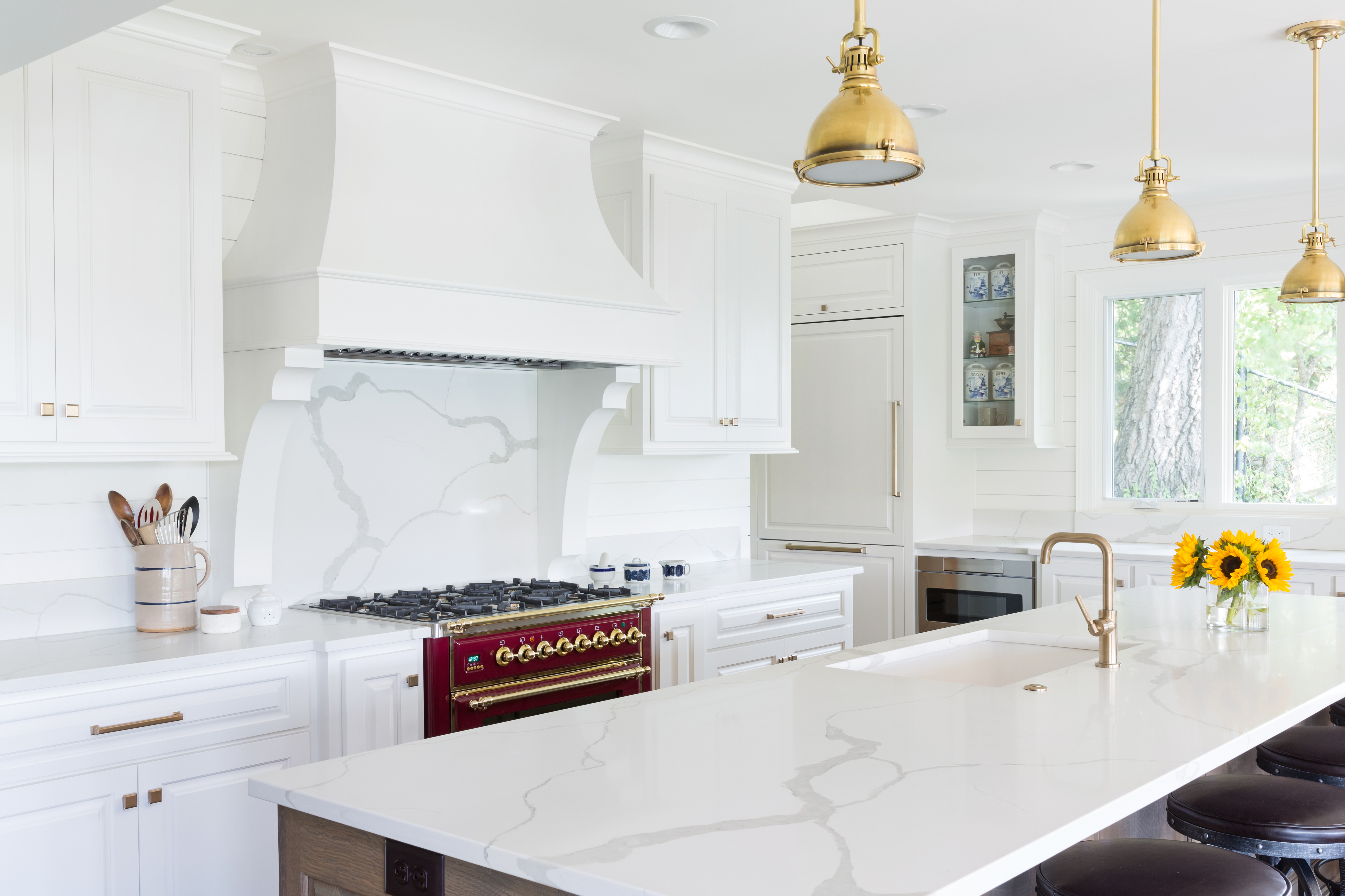 scovell remodeled white kitchen with quartz backsplash and new custom cabinetry